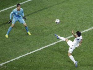 South Korea's Lee Keun-ho, right, takes a shot against Belgium's goalkeeper Thibaut Courtois during the group H World Cup soccer match between South Korea and Belgium at the Itaquerao Stadium in Sao Paulo, Brazil, Thursday, June 26, 2014. Belgium won 1-0. (AP Photo/Andrew Medichini)
